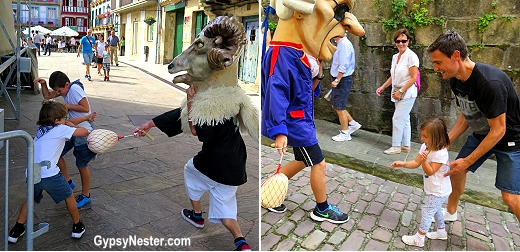 Cabezudos chase and beat children in Hondarribia, Spain