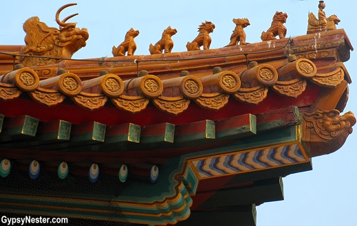 Small statues adorn the corners of the building roofs at The Forbidden City in Beijing, China. The more figures, the higher the status of the building.