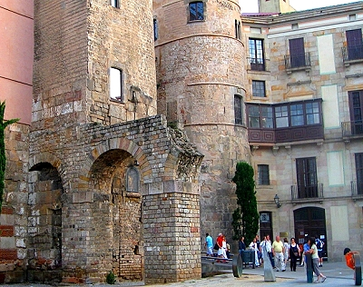 Roman gateway and an aqueduct have been incorporated into the medieval Portal del Bisbe that leads back into the Gothic Quarter