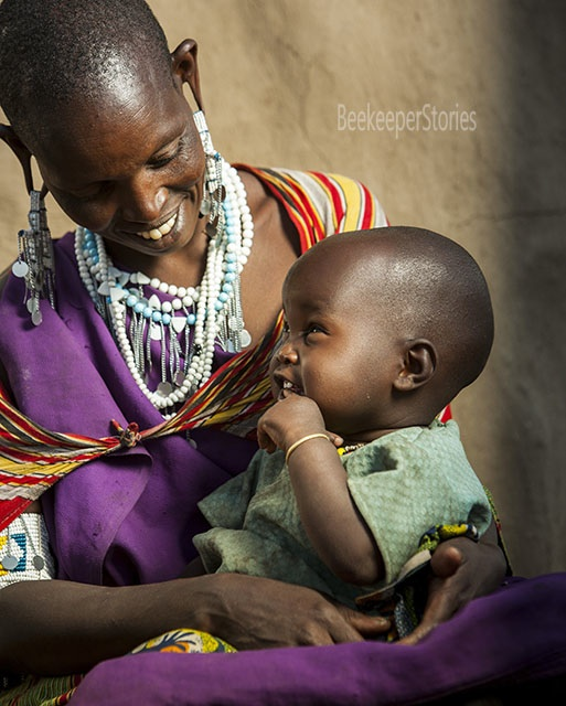 I was filming Maasai for an NGO and came up with the idea to shoot outdoor portraits with studio light. This photo of communication between mother and daughter was taken in the Maasai village - Boma, Arusha area, Northern Tanzania. Photographer: Vladimir Pcholkin Website: beekeeperstories.blogspot.ca