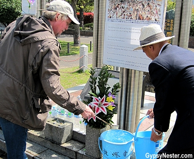David waters a plant in to honor a atomic bomb survivor in Nagasaki, Japan