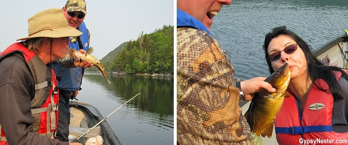 Kissing our freshly caught cod in Bay of Islands Newfoundland with Four Seasons Tours