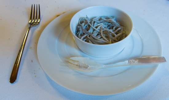 Baby eels with spork in Spain by Tom of Travel Past 50