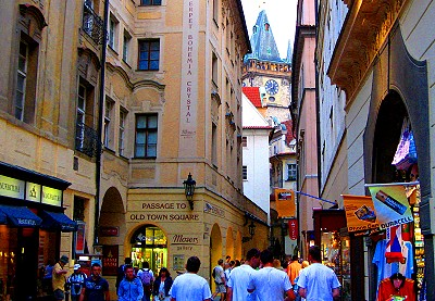The Astronomical Clock peeks through a narrow Prague street