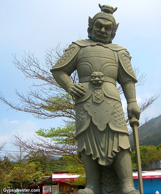 The General Catura represents 1- 3 AM and the ox of the Zodiac. He is armed with a sword.