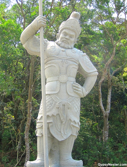 The General Indra represents 9 - 11 AM and the snake of the Zodiac. He is armed with a staff.
