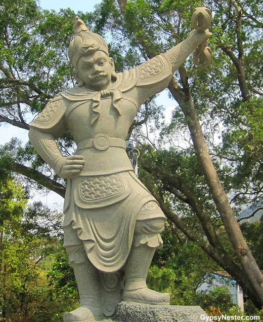 The General Mihira represents 5-7 PM and the rooster of the Zodiac. He is armed with a vajra.