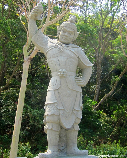The General Sandira represents 11 AM -1 PM and the horse of the Zodiac. He is armed with a conch shell.