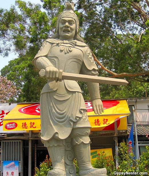 The General Vajra represents 7-9 PM and the dog of the Zodiac. He is armed with a sword.