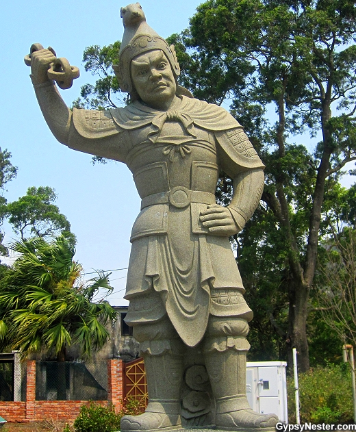 The General Vikarala represents 11 PM - 1 AM and the rat of the Zodiac. He is armed with a vajra.