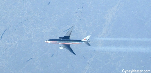 American Airlines plane seen from above over the ice floes of the Arctic Ocean